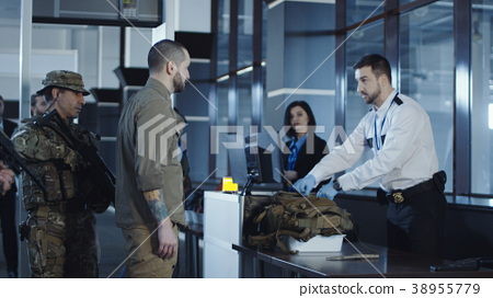 Man transitting weapon standing in airport 38955779