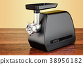 Electric meat grinder on the wooden table 38956182