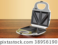 Opened sandwich maker on the wooden table 38956190