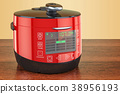 Red Automatic Multicooker on the wooden table 38956193
