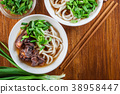 Japanese Udon noodles with beef 38958447