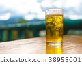 glass of beer on a wooden table 38958601
