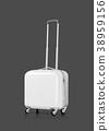 White plastic suitcase on gray background 38959156