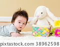 Baby boy with a rabbit celebrating Easter 38962598