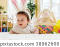 Baby boy with a rabbit celebrating Easter 38962600