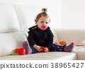 Portrait toddler baby girl playing on the sofa. 38965427