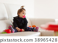 Portrait toddler baby girl playing on the sofa. 38965428