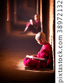 Monk study in temple 38972132