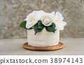 Naked wedding cake with camellias 38974143