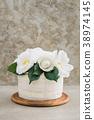 Naked wedding cake with camellias 38974145