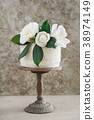 Naked wedding cake with camellias 38974149