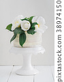 Naked wedding cake with camellias 38974150