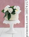 Naked wedding cake with camellias 38974157