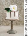 Naked drip wedding cake with camellias 38974158