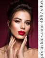 Gorgeous Young Brunette Woman face portrait. 38975965