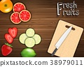 Fresh fruits slices on the table with a knife on a 38979011