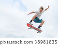 Young skateboarder in a jump 38981835