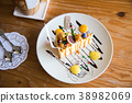 cheesecake with popcorn and caramel sauce 38982069