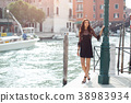 Travel tourist woman on pier against beautiful 38983934