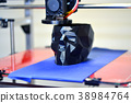 3D printer printing a model in the form of black 38984764
