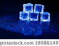 Blue ice cubes on black background. 38986149