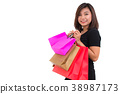 Asian woman with colorful shopping bags. 38987173