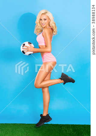 Sexy blonde posing with a ball as a football 38988134