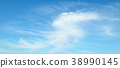 Light clouds in the blue sky. Wide photo. 38990145
