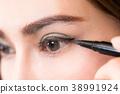 Beautiful woman make-up with black eyeliner. 38991924