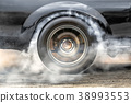 Drag racing car burn tire prepare for the race 38993553