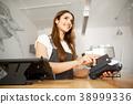 Coffee Business Concept - Beautiful female barista 38999336