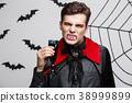 Vampire Halloween Concept - Portrait of Serious 38999899