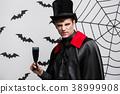 Vampire Halloween Concept - Portrait of handsome 38999908