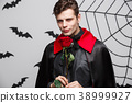 Vampire Halloween Concept - Portrait of handsome 38999927