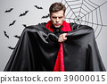 Vampire Halloween Concept - Portrait of handsome 39000015