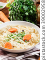 Tasty meat broth with noodles, carror and parsley 39002958