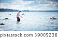eight years old boy playing at the beach in sailor 39005238