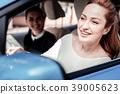 Joyful stylish woman looking on the road sitting 39005623