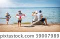 Babygirl and babyboy sitting on the beach 39007989