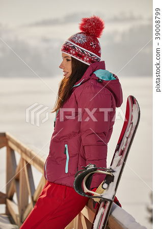 Sexy snowboarder woman outdoors. Winter resort 39008799