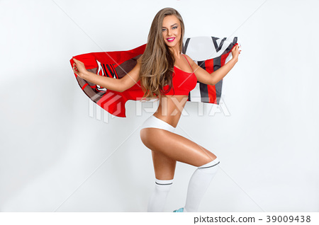 Beautiful sports girl soccer cheerleader with flag 39009438