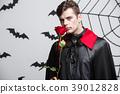 Vampire Halloween Concept - Portrait of handsome 39012828