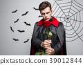 Vampire Halloween Concept - Portrait of handsome 39012844