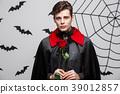 Vampire Halloween Concept - Portrait of handsome 39012857