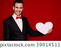 Stylish man in suit hold paper heart 39014511