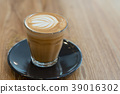 Hot coffee cup on wooden table 39016302
