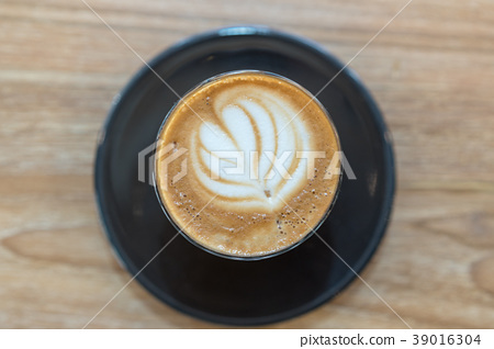 Hot coffee cup on wooden table 39016304