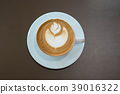 Hot coffee cup on wooden table 39016322