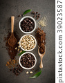 Different varieties of coffee beans with sugar and 39023587