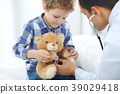 Doctor and child patient. Physician examines 39029418